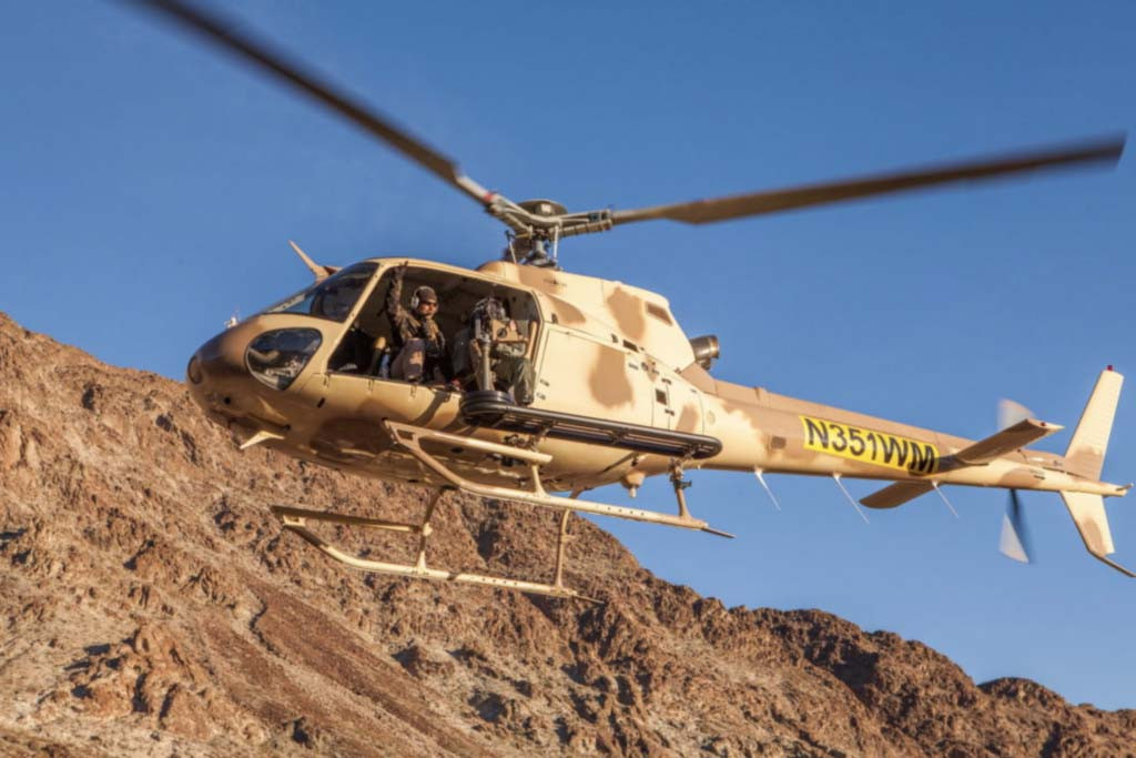 Shoot-machine-guns-out-of-a-helicopter